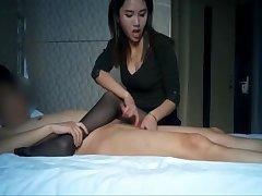 Superb asian youthful slut giving a handjob