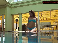 Russian mermaid Mia Ferrari performs hot underwater striptease show