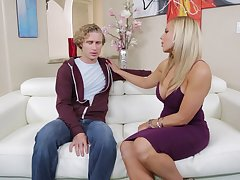 Busty blonde Olivia Austin spreads her limbs and rides a long cock