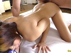 Tatted up Thai slut is very into having coition on camera